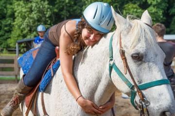 girl-hugs-horse